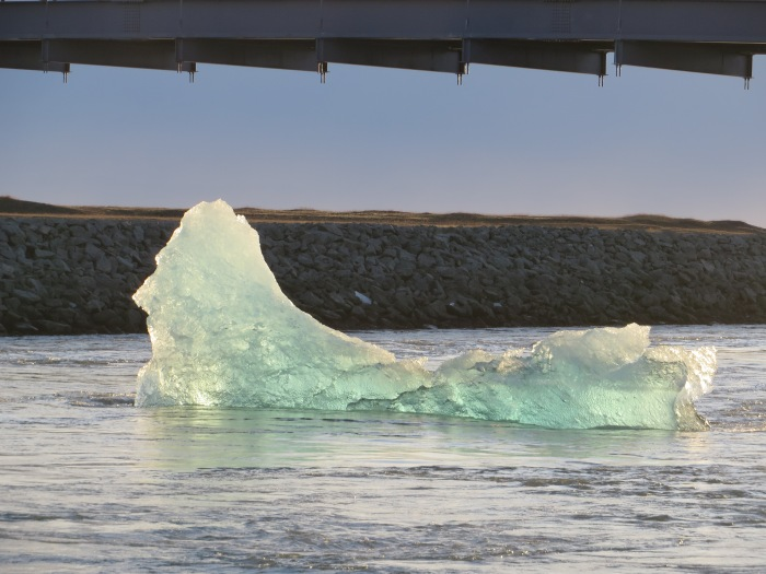 Iceberg floating out to sea under Ring Road bridge (Jökulsárlón)