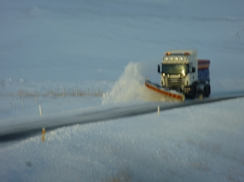 A welcome snowplow (they're often in better focus)
